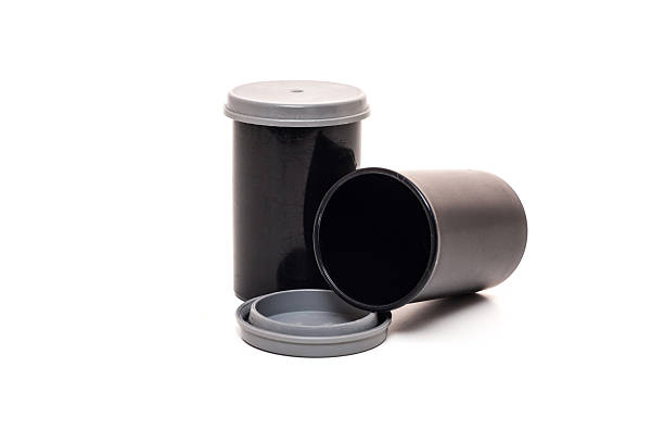 Standard film canister. All on white background stock photo