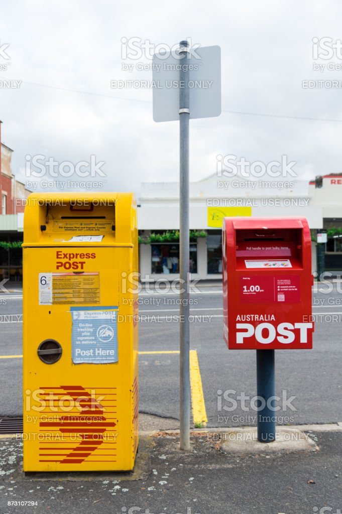Standard red and yellow Express Post post boxes of Australia Post. stock photo