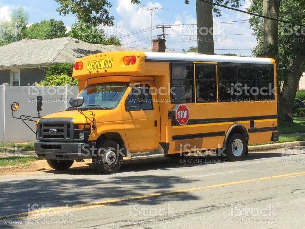 Standard Short School Bus Parked On Street Stock Photo