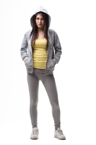 standard studio portrait of a woman in tracksuit - fly away haar stock-fotos und bilder
