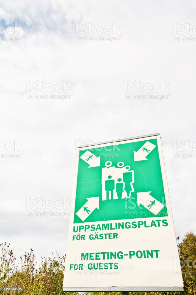 ISO Standardized Pictogram For Fire Safety Assembly Point For Guests (And In Swedish) stock photo