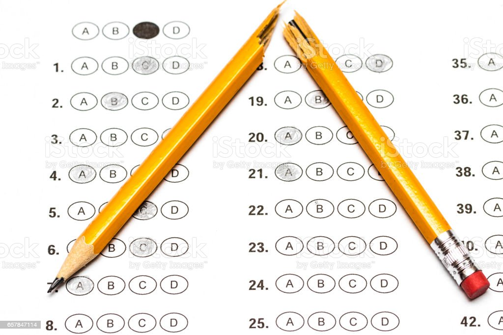 Standardized test form with answers and a broken pencil stock photo