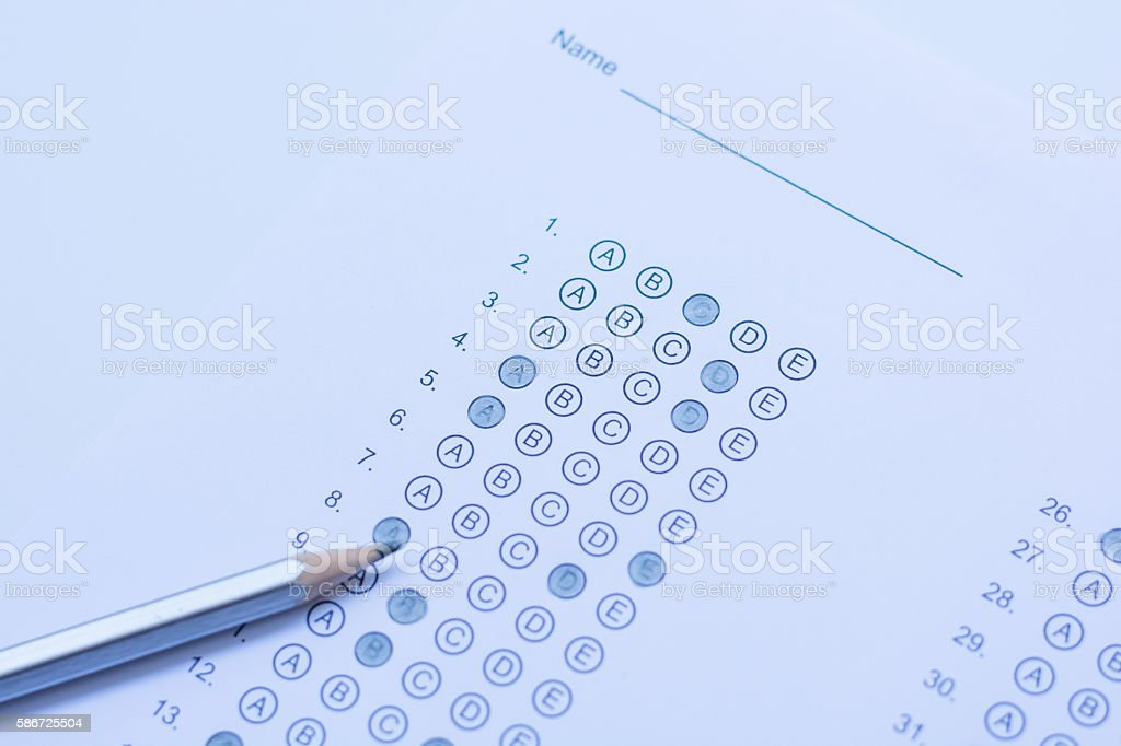 Standardized test form with answers bubbled in and a pencil stock photo