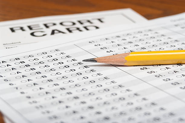 Standardized test with pencil and report card stock photo