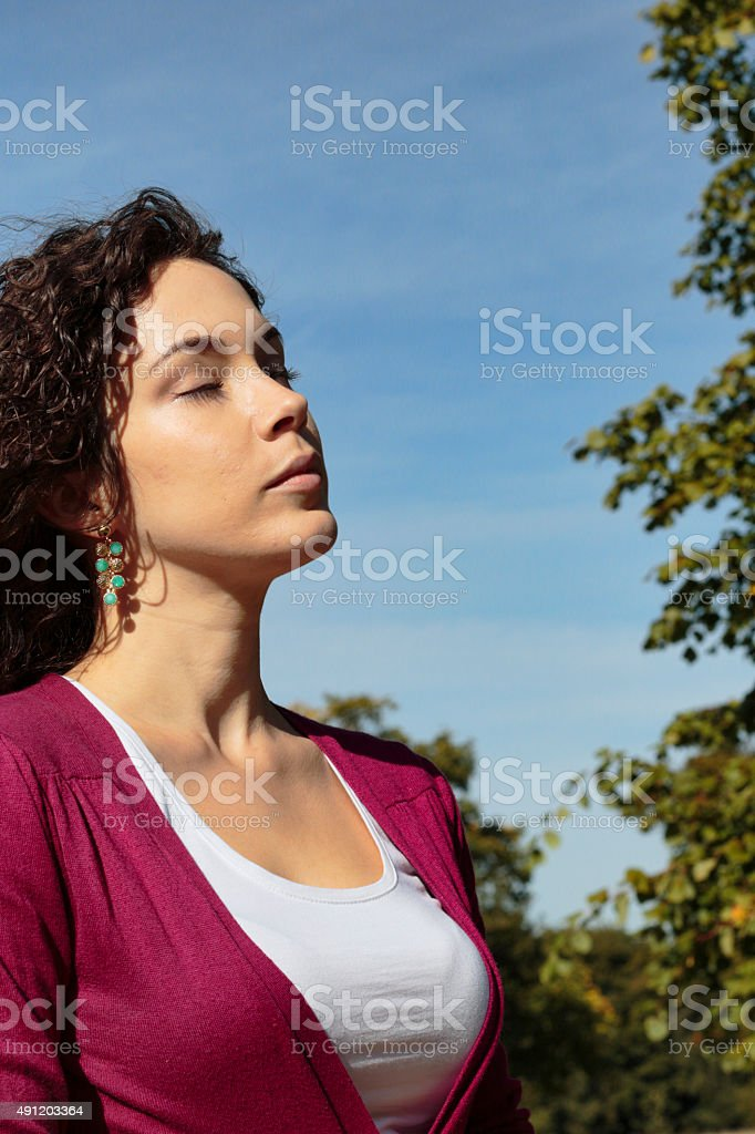 Beautiful shapely Canadian outdoor girl on Mitcham Common stock photo