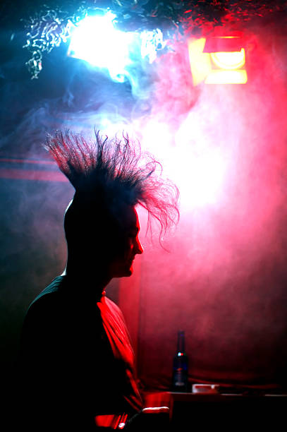 standing at the bar silhouette of a gothic/punk guy with a mohawk haircut in a discotheque goth stock pictures, royalty-free photos & images