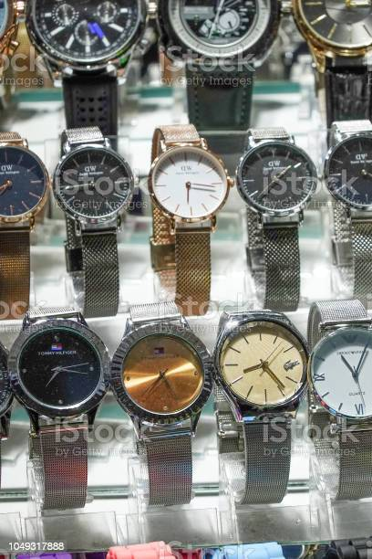 Standing at the bazaar with a bunch of fake brand watches picture id1049317888?b=1&k=6&m=1049317888&s=612x612&h=zlwikm4659t7kmiv959xllmnoqv9jfd3gckbxjsbc5w=