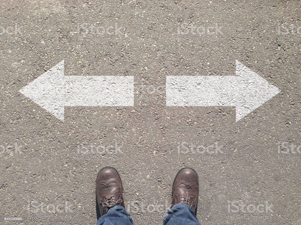 standing at the crossroad making decision which way to go stock photo