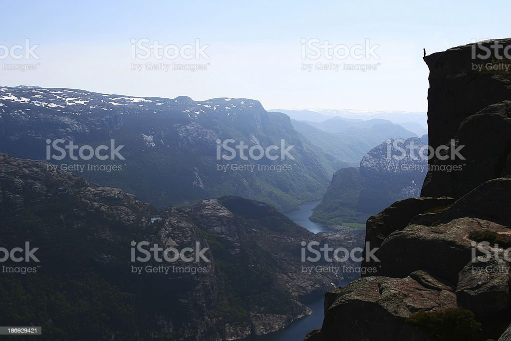 Standing at the Edge - Norwegian Fjord royalty-free stock photo