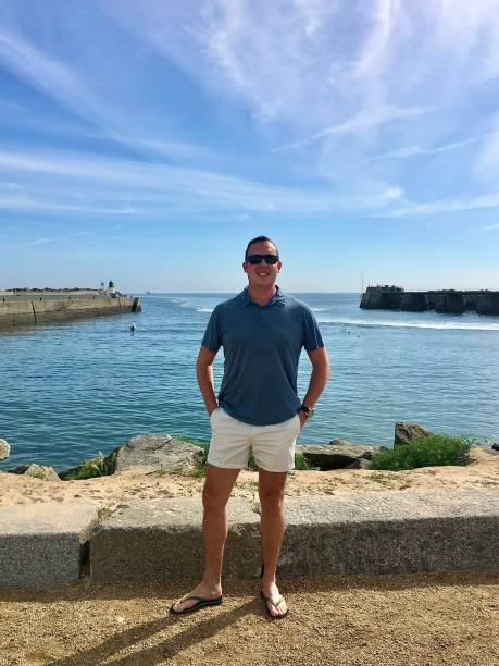 Standing at the Île d'Yeu harbour entrance. stock photo