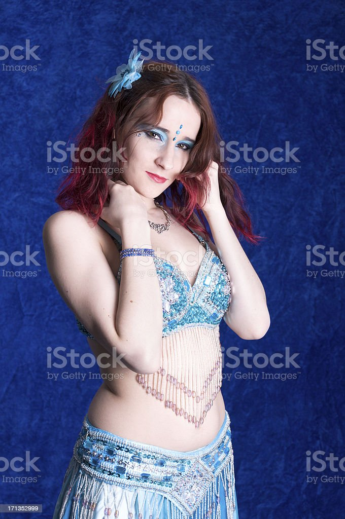 Standing bellydancer with hands in hair. royalty-free stock photo