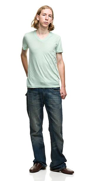 gelangweilt jungen mannes stehend - geek t shirts stock-fotos und bilder