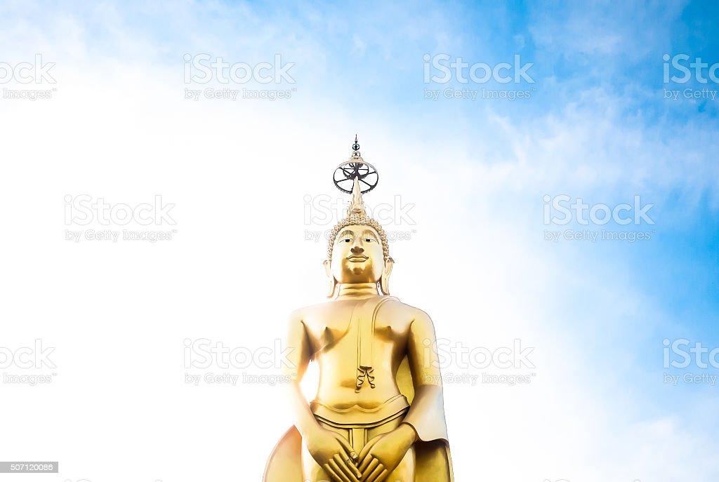 Standing Buddha Statue In Blue Sky, stock photo