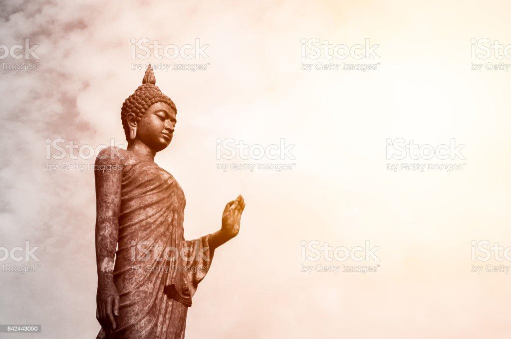 Standing buddha statue stock photo