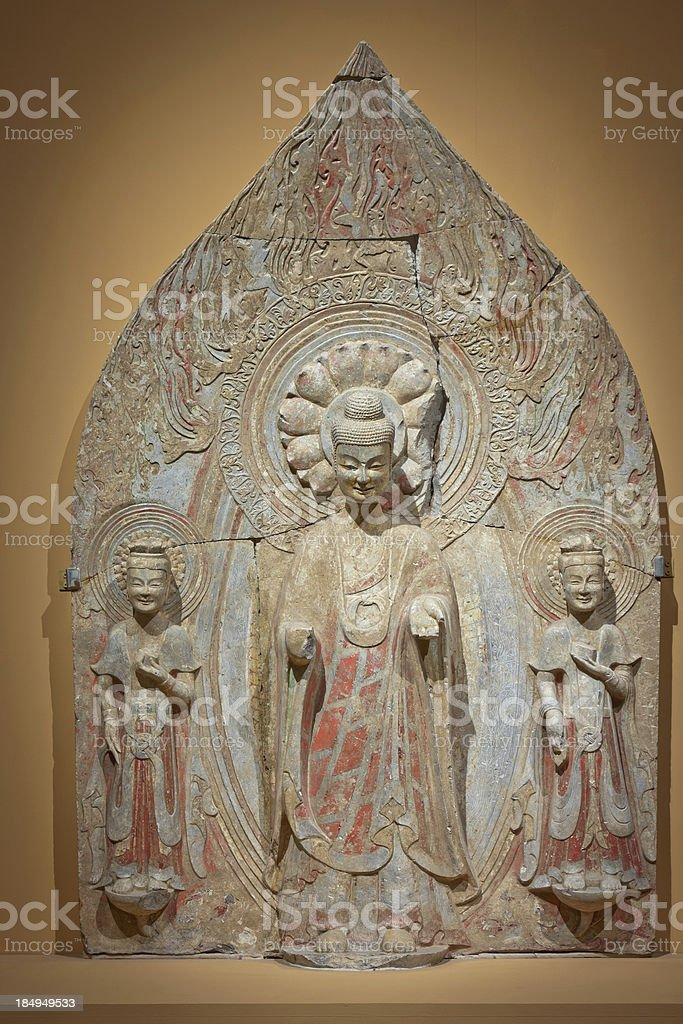 standing buddha with two bodhisattvas royalty-free stock photo