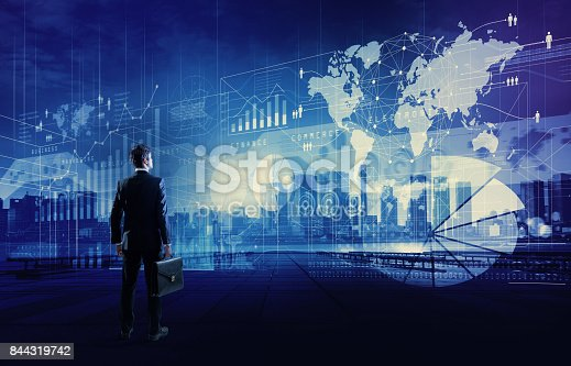 919567592 istock photo standing businessman who looks various graphics of business. Internet of Things. Information Communication Technology. Digital transformation. Abstract mixed media. 844319742