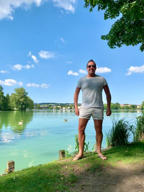Standing by the lake. stock photo
