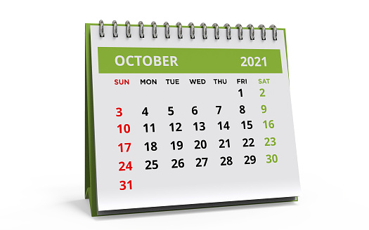Standing Desk Calendar October 2021. Business monthly calendar with metal spiral-bound, the week starts on Sunday. Monthly Pages on a white base and green title, isolated on a white background, 3d render.