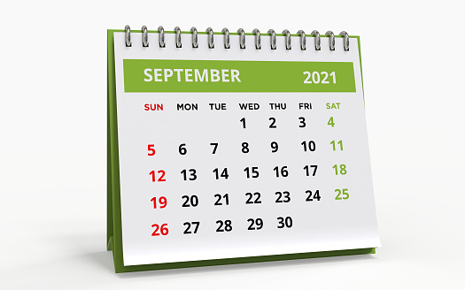Standing Desk Calendar September 2021. Business monthly calendar with metal spiral-bound, the week starts on Sunday. Monthly Pages on a white base and green title, isolated on a white background, 3d render.