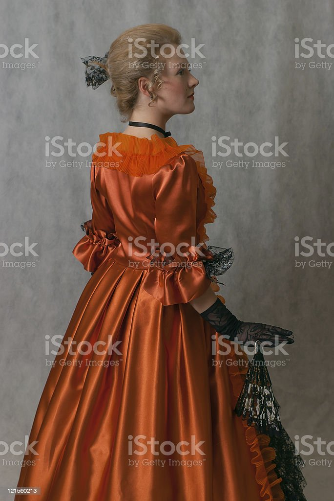 standing girl in baroque dress royalty-free stock photo