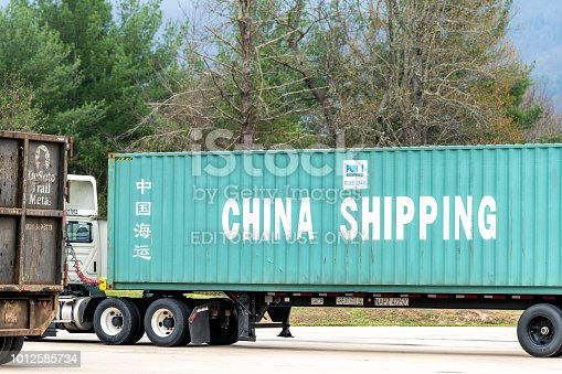 Erwin, USA - April 19, 2018: Standing idle truck at Tennessee Visitor Center, rest area transporting China Shipping Line trade goods, products container in United States