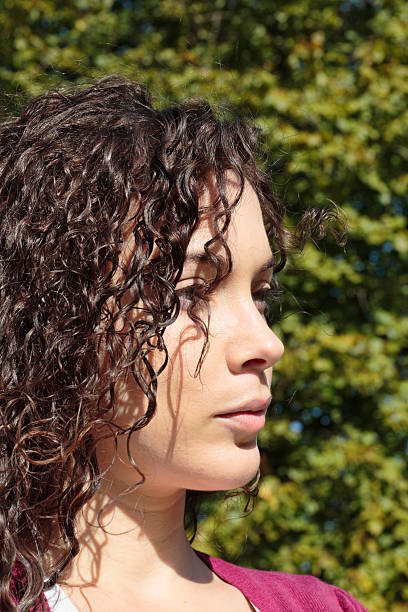 profile face curly-haired beautiful shapely canadian outdoor girl - whiteway canadian outdoor girl stock photos and pictures