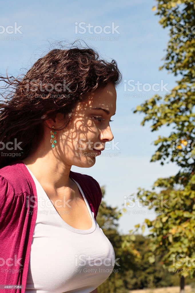 Beautiful curly-haired Canadian outdoor girl on Mitcham Common stock photo
