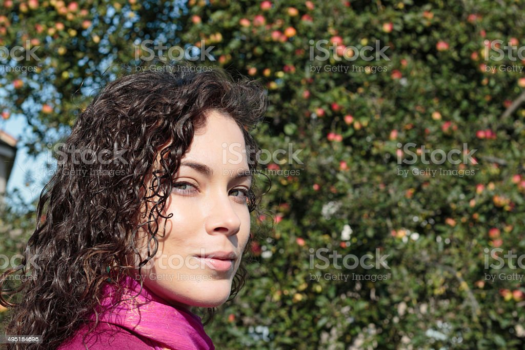 Smiling face curly-haired beautiful shapely Canadian outdoor girl stock photo