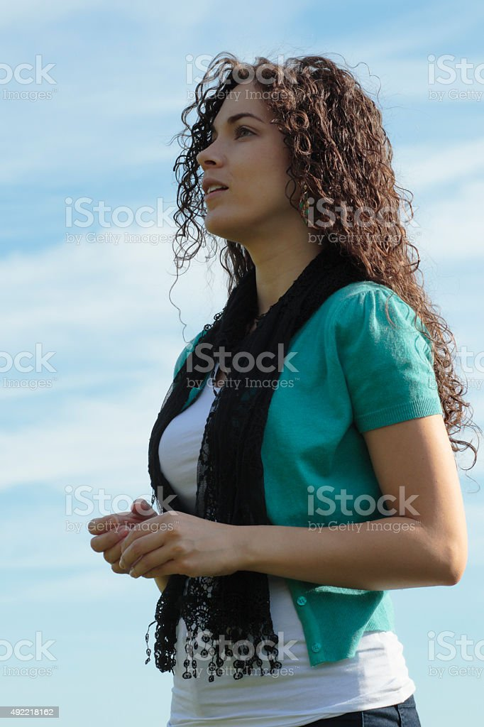 Beautiful shapely Canadian outdoor girl against the sky stock photo