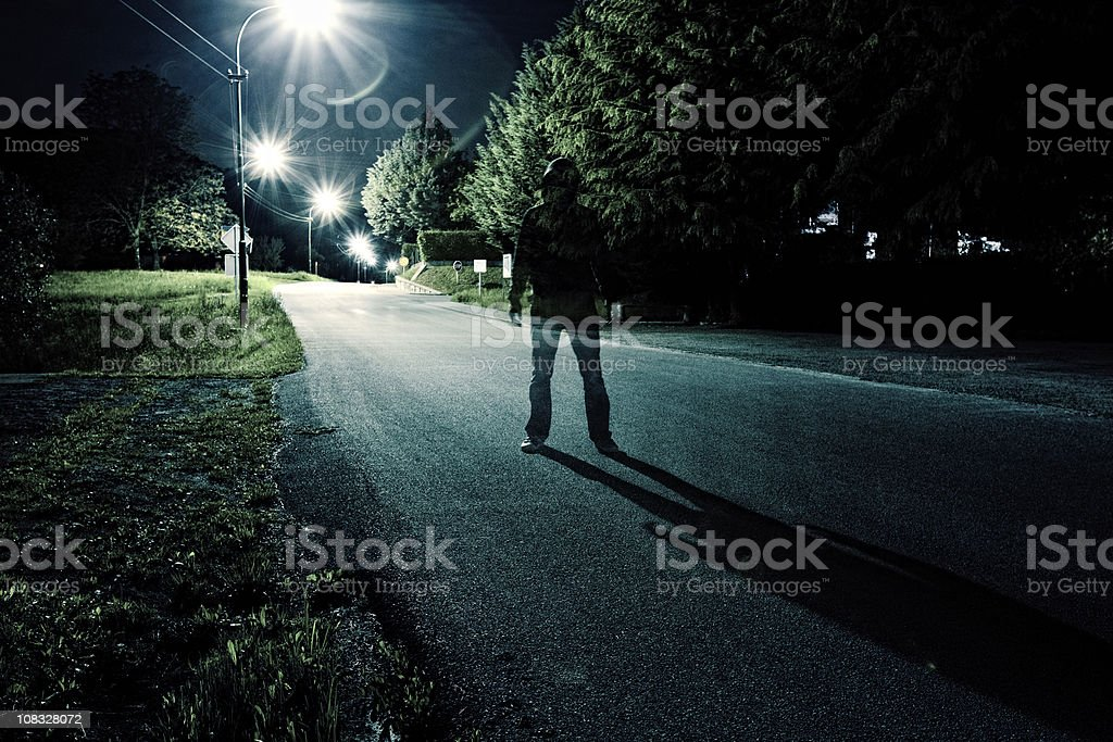 standing in the middle of road stock photo
