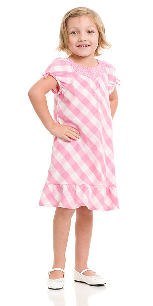 Standing Little Girl In Pink Dress stock photo