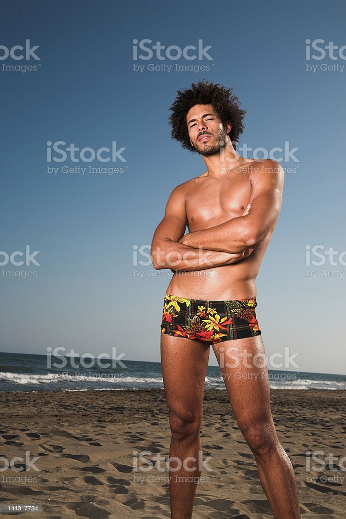 Standing man on the beach royalty-free stock photo