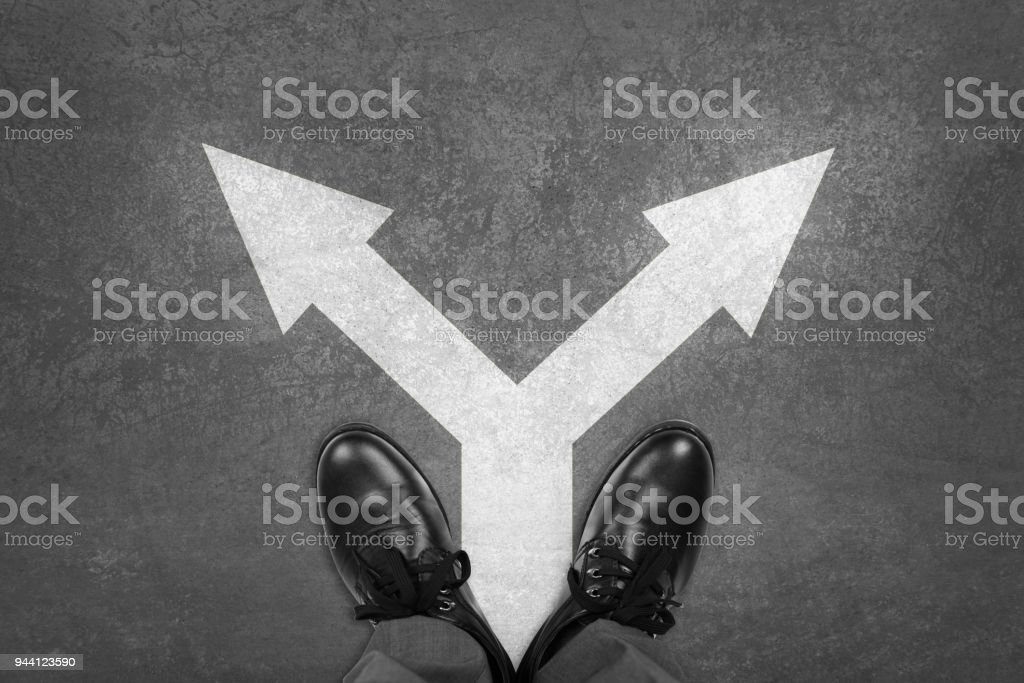 Standing Man with Two Choices stock photo