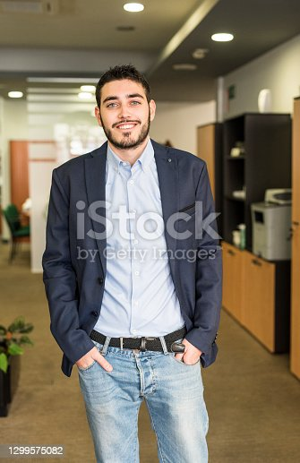 Standing office worker looking at camera smiling