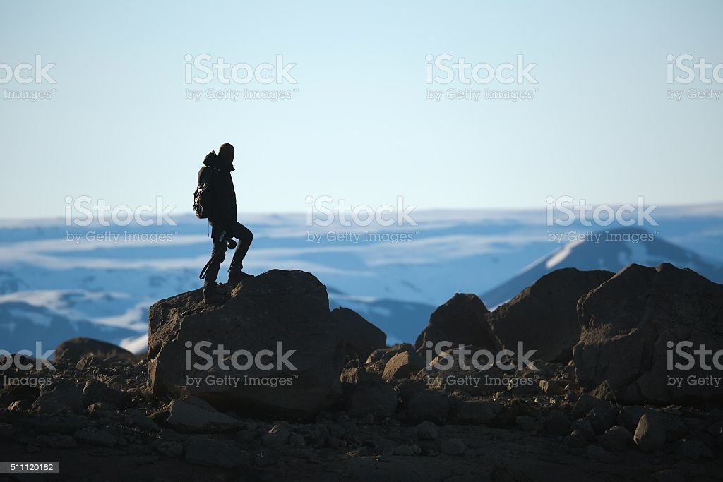 Standing on a cliff stock photo