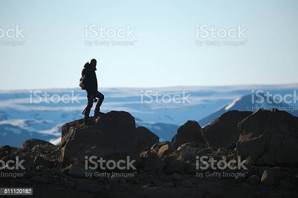 Photo of Standing on a cliff