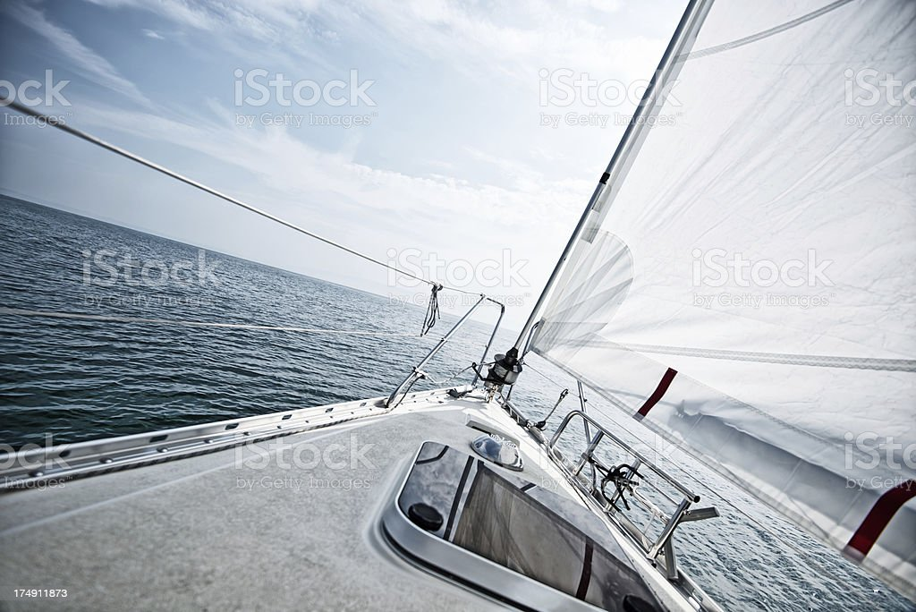 Standing on a sailboat deck during sailing trip stock photo