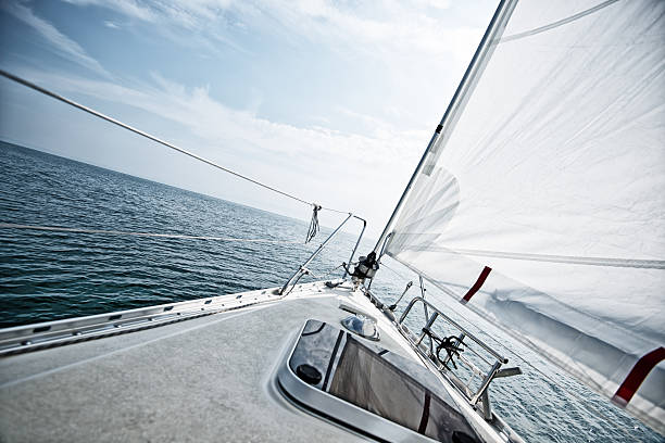 standing on a sailboat deck during sailing trip - yacht front view stock photos and pictures