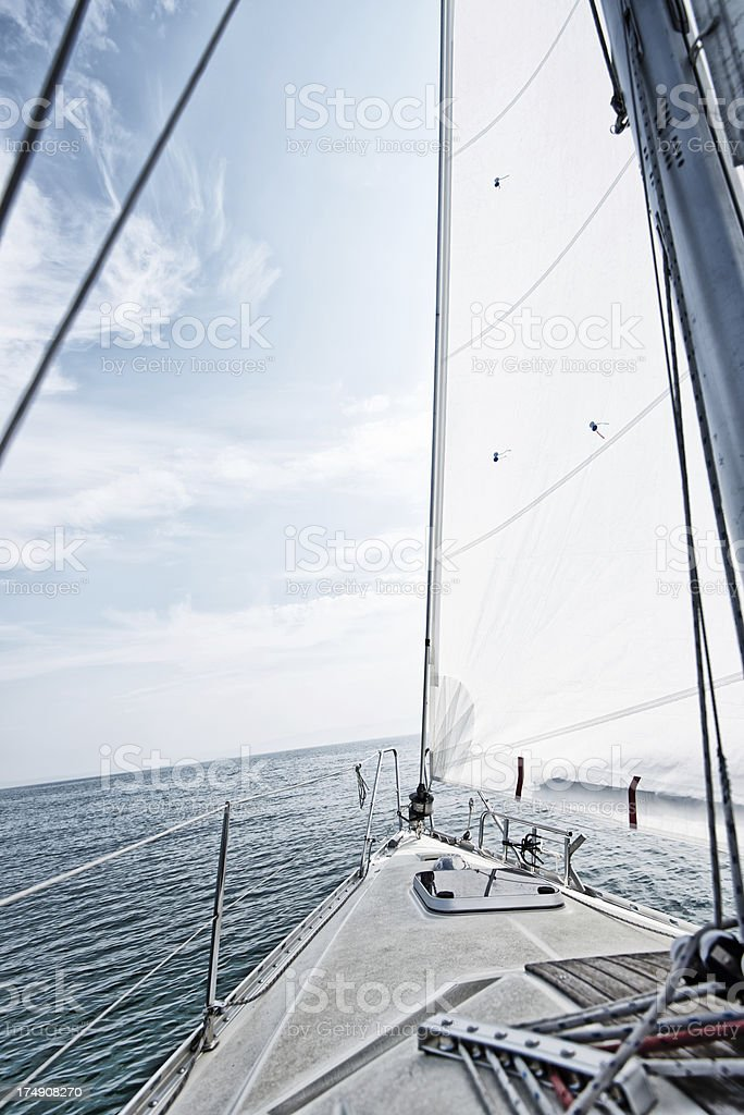 Standing on a sailboat deck looking to ship's bow stock photo