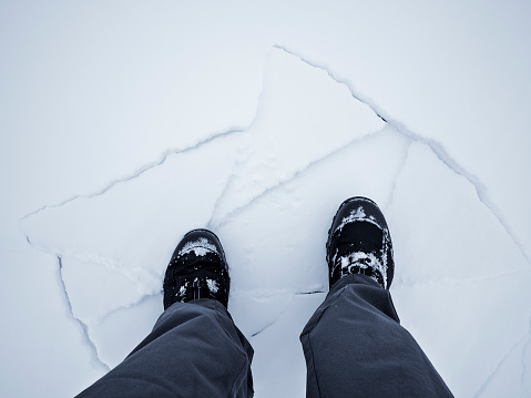 Standing On Broken Block Of Ice