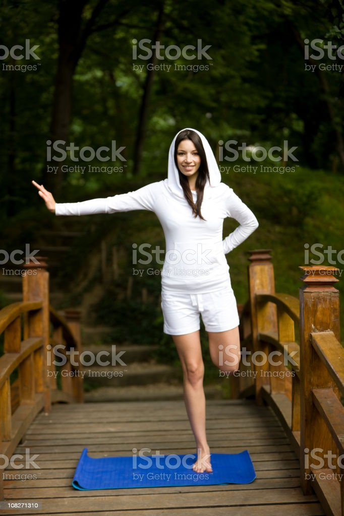 Standing on one leg royalty-free stock photo