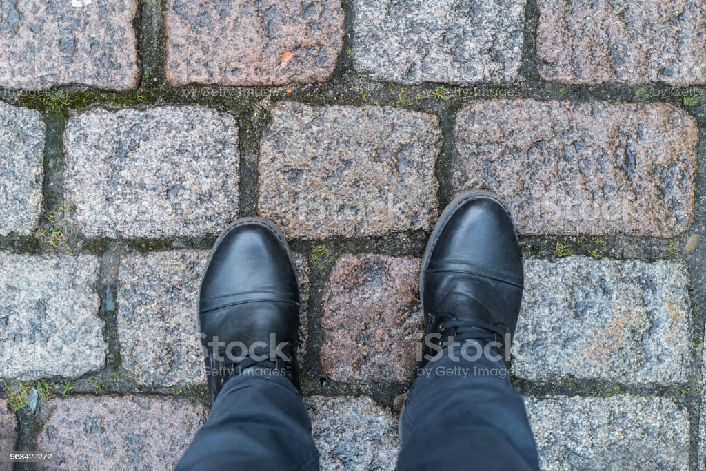 Standing on Pavement stock photo