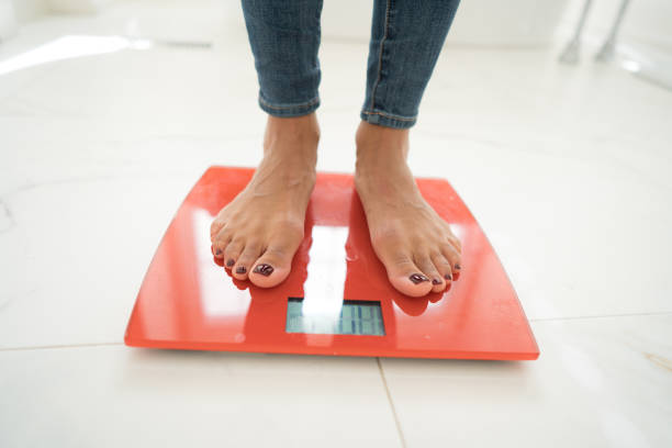 standing on scales - scale stock photos and pictures