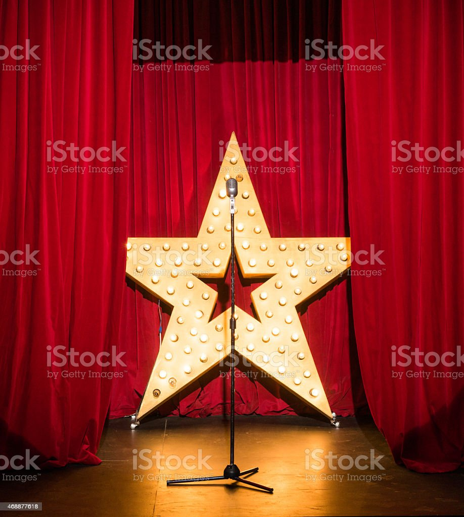 Standing on stage concert, vintage microphone stock photo