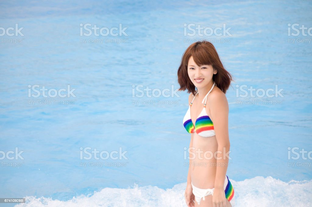 Standing on the beach with swimming pool swimsuit women royalty-free stock photo