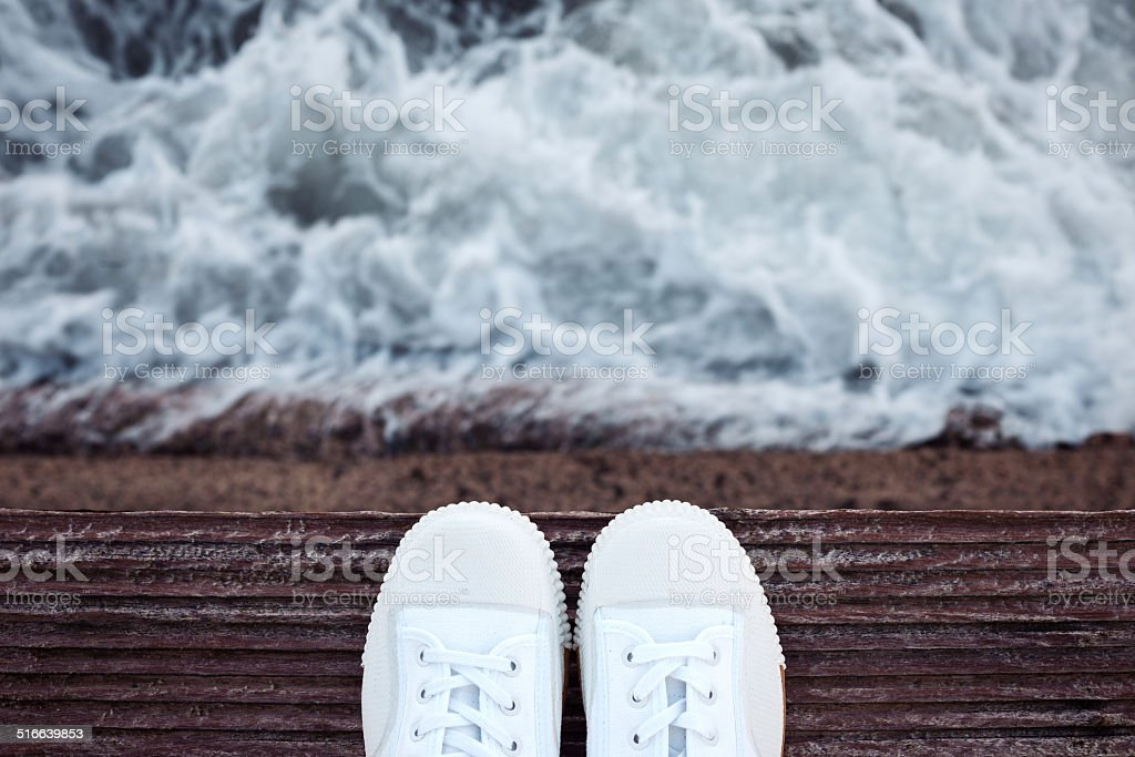 standing on the cliff near the sea stock photo