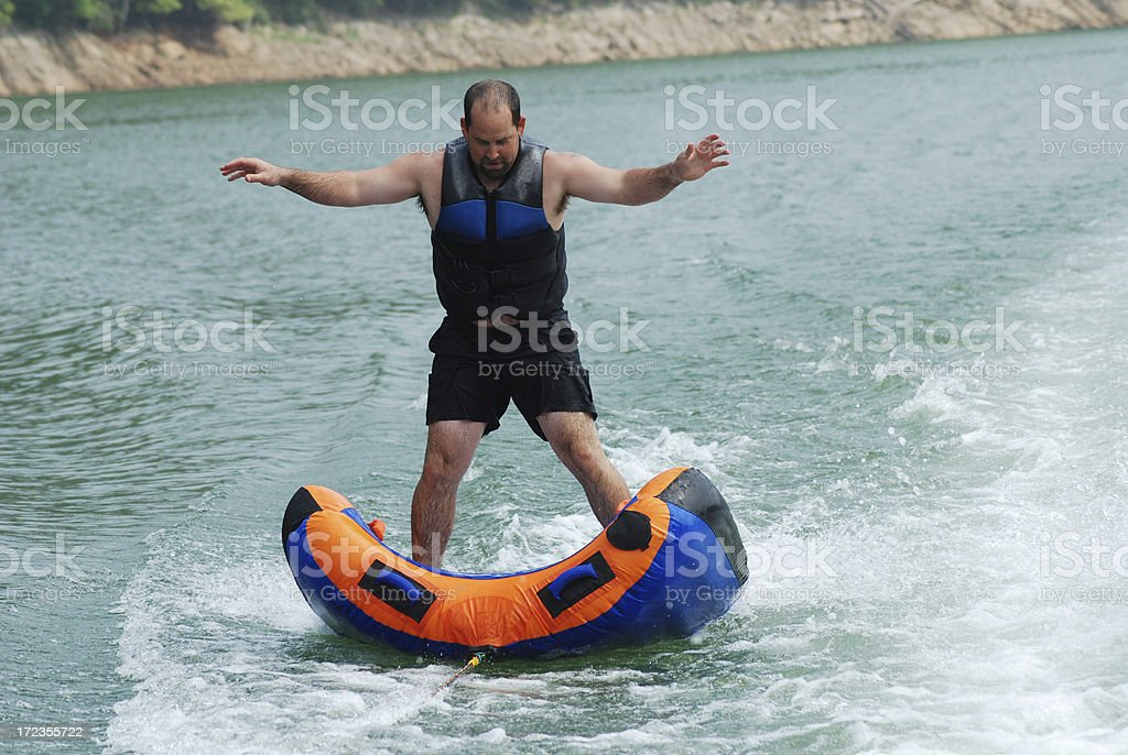 Standing on the Inner Tube royalty-free stock photo