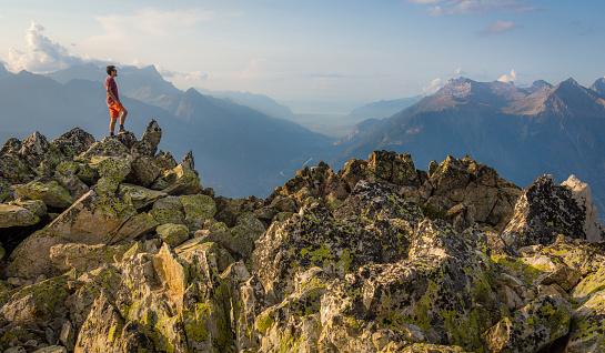 istock Standing on the mountain summit 1096558492