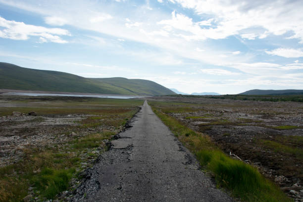 Standing on the road that is normally submerged by Loch Glascarnoch stock photo