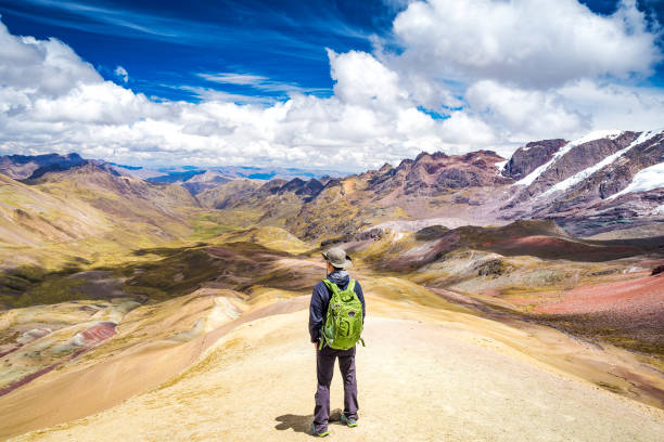 Standing on the top of Rainbow Mountain. stock photo